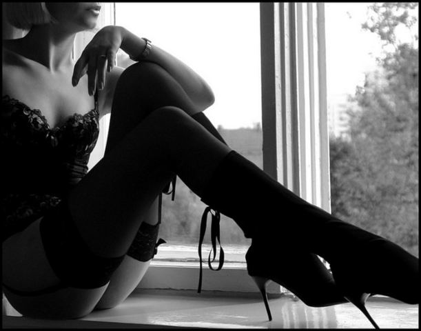 Sensual lady at window